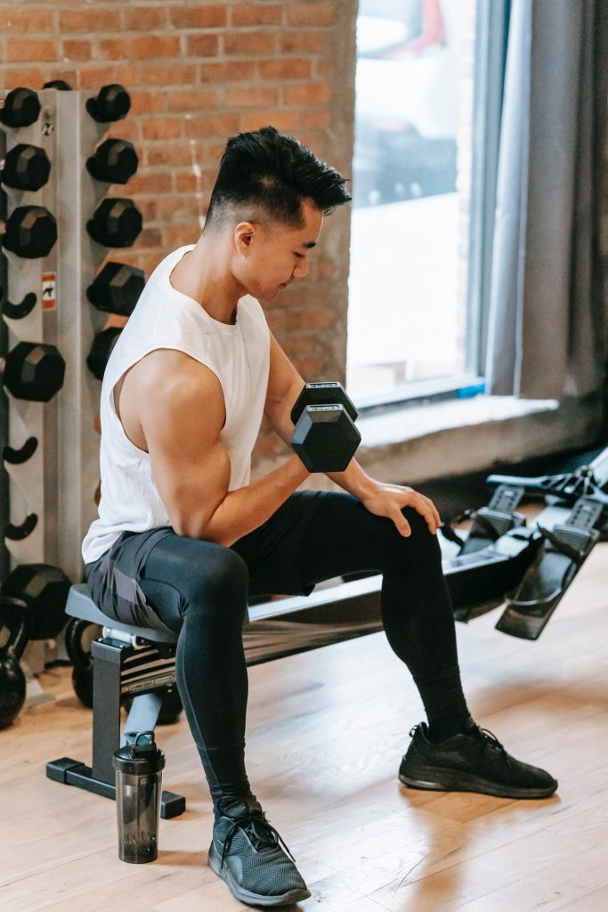 Athlete working out with dumbells